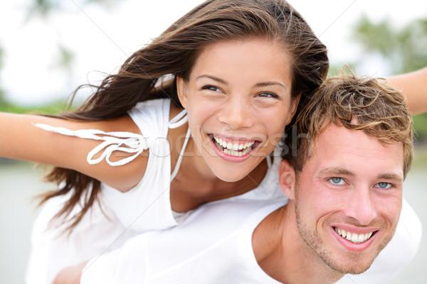 Boldog pár tengerpart szórakozás háton szeretet Stock fotó © Maridav