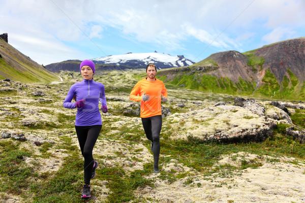 Sport running - runners on cross country trail Stock photo © Maridav