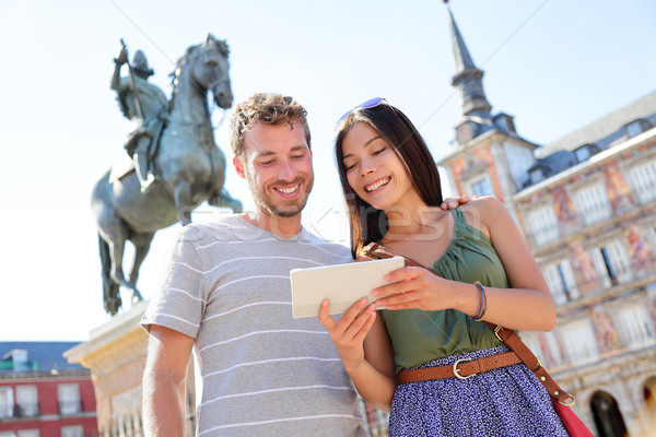 Madrid tourists using tablet travel app Stock photo © Maridav