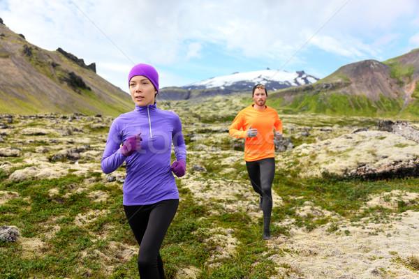 Running sport - runners on cross country trail Stock photo © Maridav