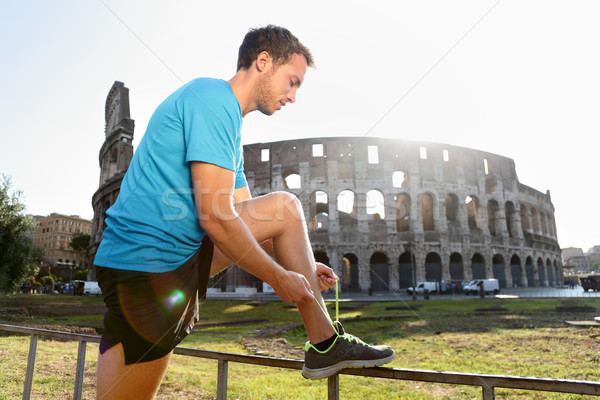 Stock photo: Jogger Running Tying Shoelaces by Colosseum