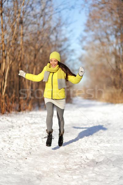Happy girl running in snow winter landscape Stock photo © Maridav