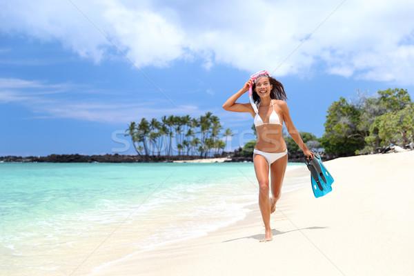 Happy bikini woman relaxing on white sand beach Stock photo © Maridav