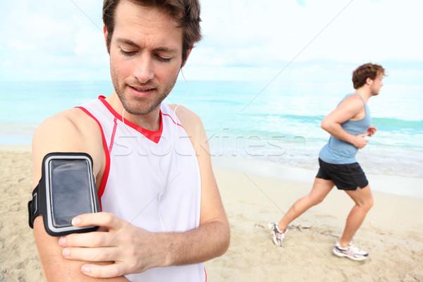 Running workout with music Stock photo © Maridav