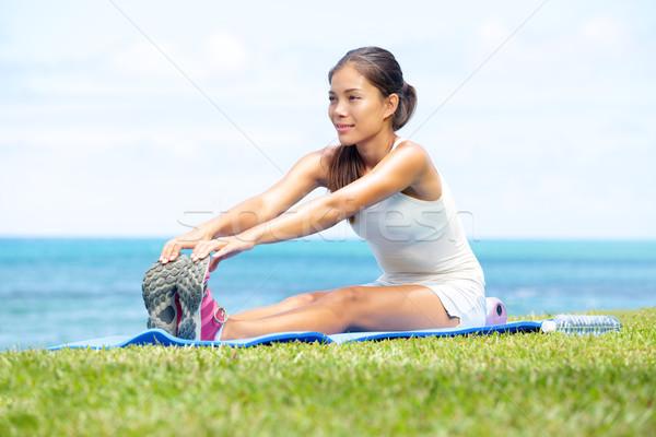 Woman training fitness stretching legs exercise Stock photo © Maridav
