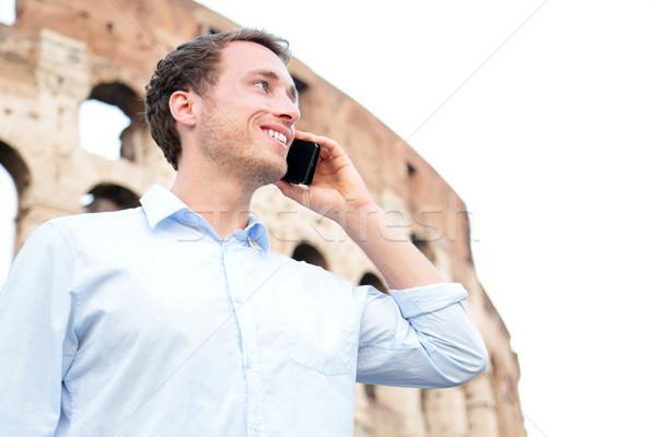 деловой человек сотового телефона Колизей Рим Италия молодые Сток-фото © Maridav
