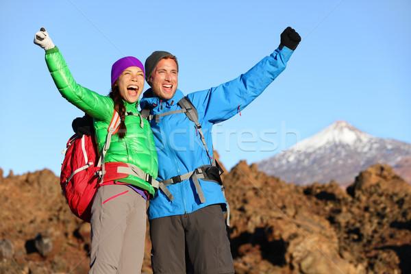 Happy celebrating hiking people at top Stock photo © Maridav