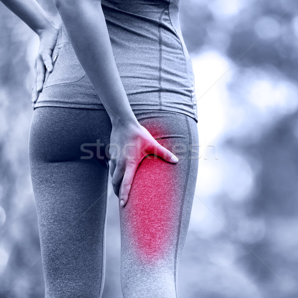 Hamstring sprain or cramps. Running sports injury with female runner. Stock photo © Maridav