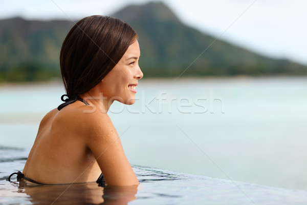 Vacation woman swimming at infinity pool on Hawaii Stock photo © Maridav