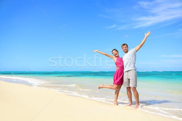 Stock photo: Freedom on beach vacation - happy carefree couple