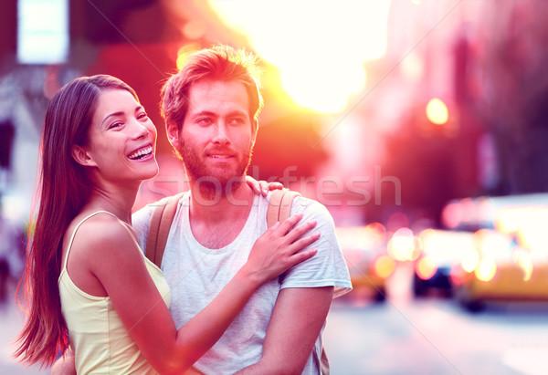 Happy young couple enjoying urban city lifestyle Stock photo © Maridav