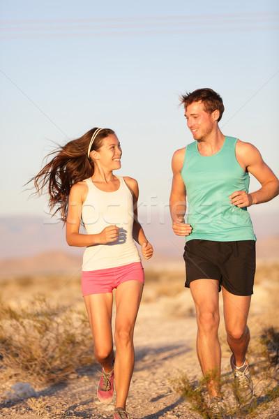 Runners - Active fitness couple running laughing Stock photo © Maridav