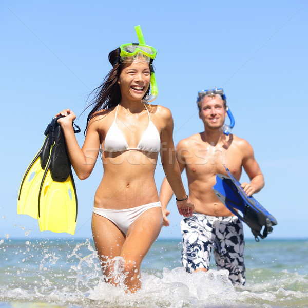 Beach couple having fun on vacation travel snorkel Stock photo © Maridav