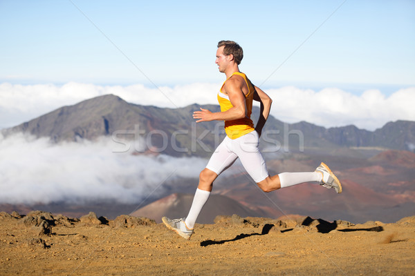 Runner man athlete running sprinting fast Stock photo © Maridav