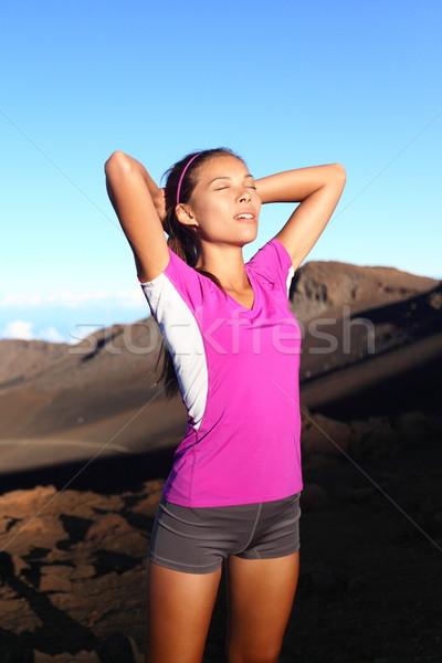 Athlete runner woman relaxing after running Stock photo © Maridav