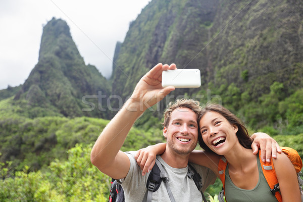 Couple taking selfie with smartphone hiking Hawaii Stock photo © Maridav