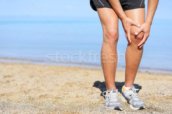 Running injury - Man jogging with knee pain Stock photo © Maridav