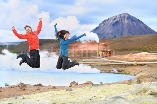Iceland travel people jumping of joy in nature Stock photo © Maridav