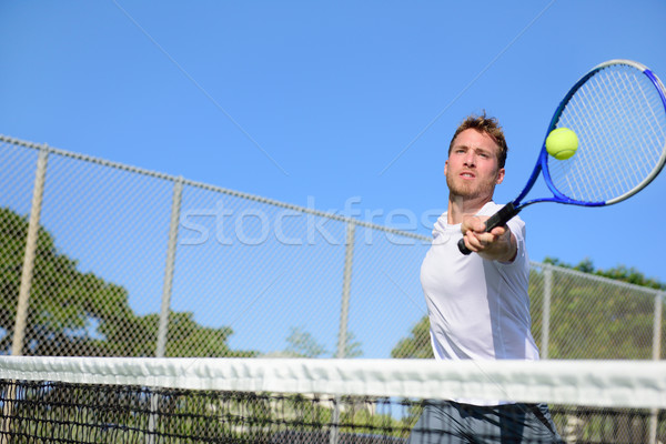 Tennis player man hitting ball in a volley Stock photo © Maridav