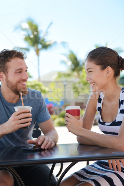 Cafe couple having fun drinking coffee talking Stock photo © Maridav