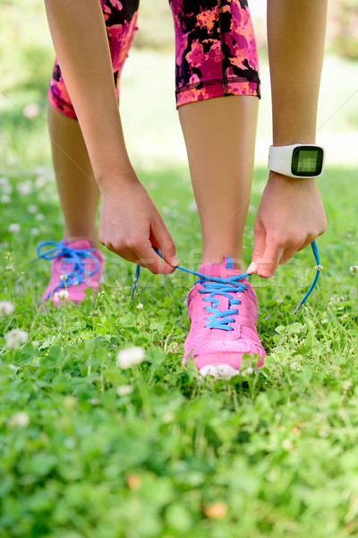 Weight loss - runner tying laces with smartwatch Stock photo © Maridav