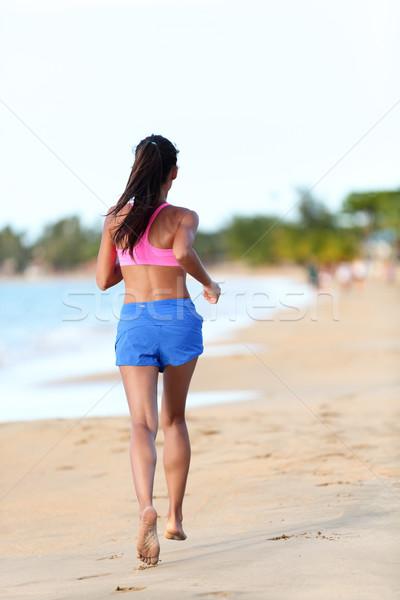 Fitt nő jogging tengerpart hátsó nézet fiatal Stock fotó © Maridav