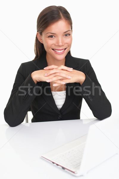 Young businesswoman sitting at desk Stock photo © Maridav