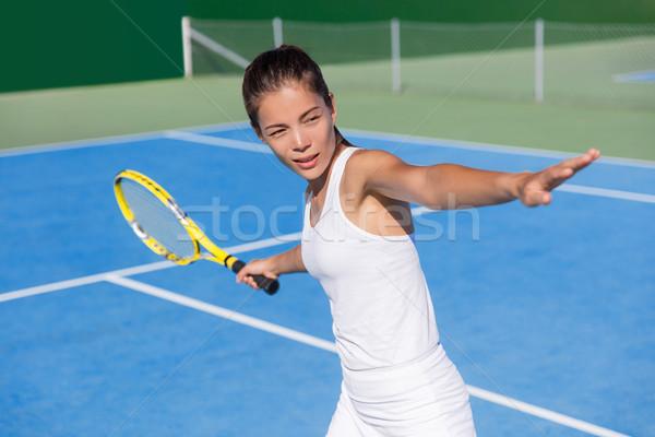 Asian tennis player woman playing hitting forehand Stock photo © Maridav
