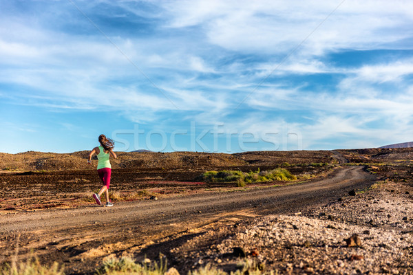 Stock photo: Trail runner woman athlete running fast in lanscape