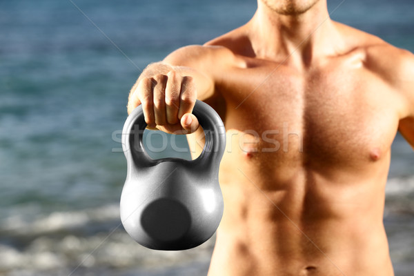 Crossfit fitness man training with kettlebell Stock photo © Maridav