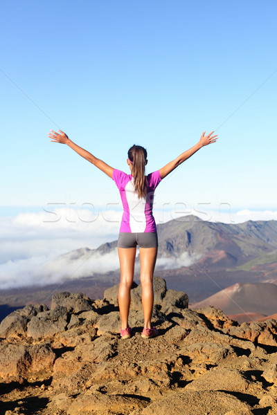 Success and achievement - hiking woman on top Stock photo © Maridav