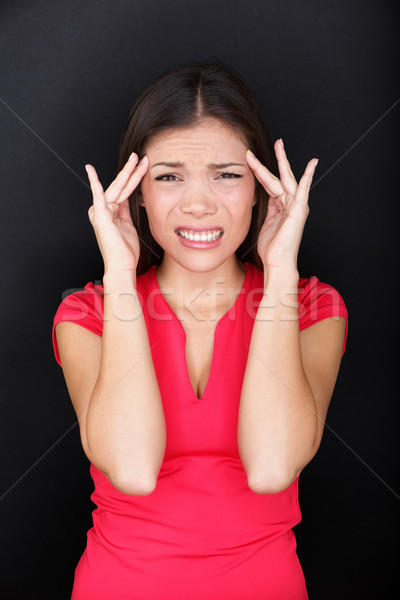 Stressed woman with headache stress migraine Stock photo © Maridav