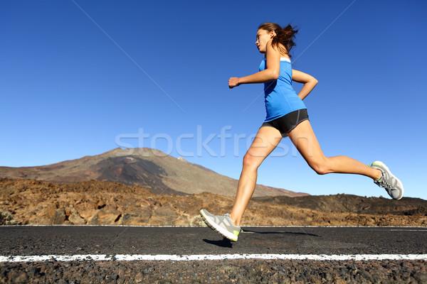 Sprinting running woman - female runner training Stock photo © Maridav