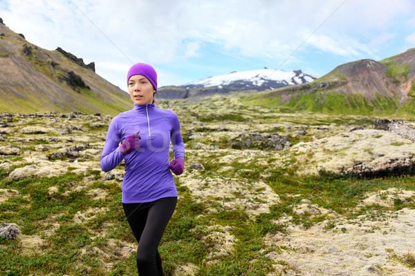 Running woman exercising - trail runner athlete Stock photo © Maridav