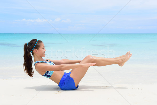 Fitness woman doing v-up crunch ab toning exercise Stock photo © Maridav