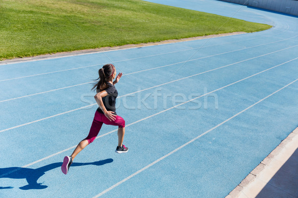 Stock photo: Runner sprinting towards success on running track