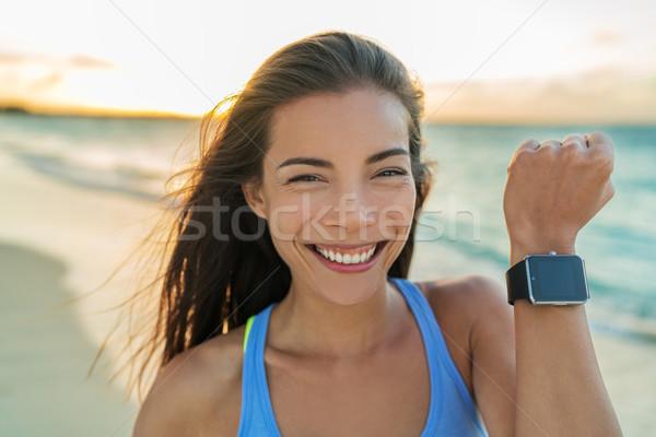 Smartwatch happy girl showing screen on watch Stock photo © Maridav
