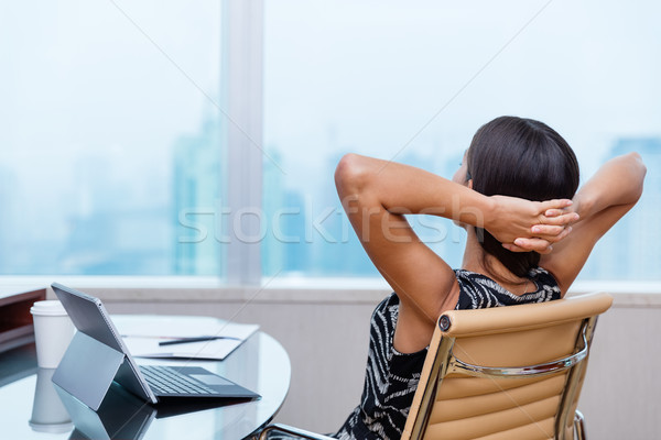 Business woman relaxing working at office desk Stock photo © Maridav