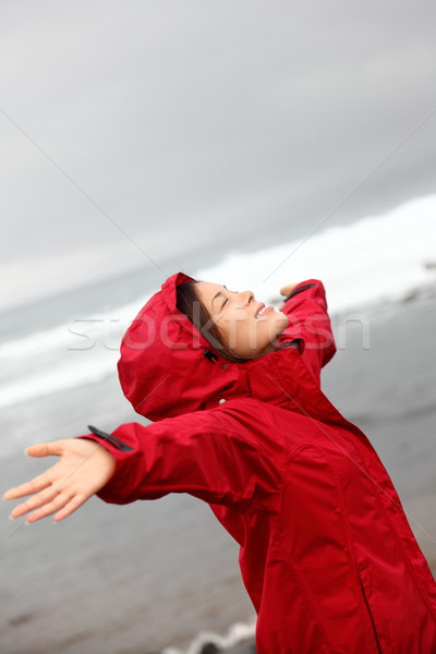 fall woman in rain happy by ocean Stock photo © Maridav