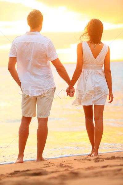 ストックフォト: 手をつない · ビーチ · 日没 · ロマンス