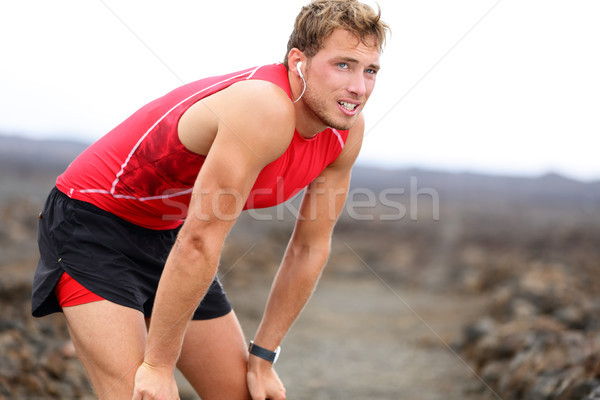 Runner man resting with music after running Stock photo © Maridav
