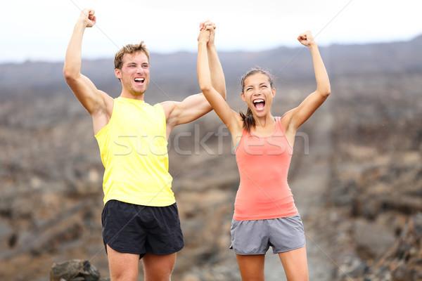 Cheering celebrating happy fitness runner couple Stock photo © Maridav