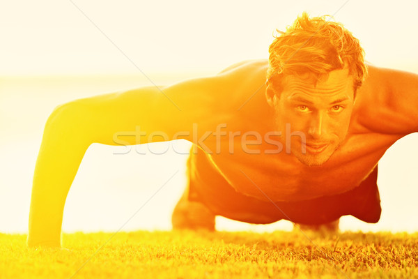 Sport fitness man push-ups Stock photo © Maridav