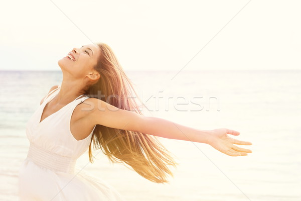 Freedom woman in free happiness bliss on beach Stock photo © Maridav