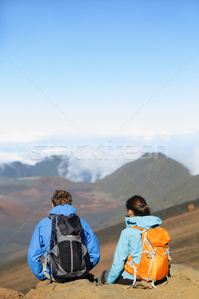 Hikers - people hiking sitting enjoying summit top Stock photo © Maridav