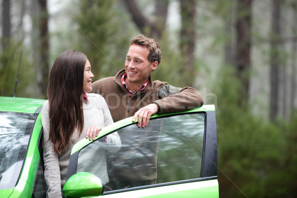 Car people - happy couple driving on road trip Stock photo © Maridav
