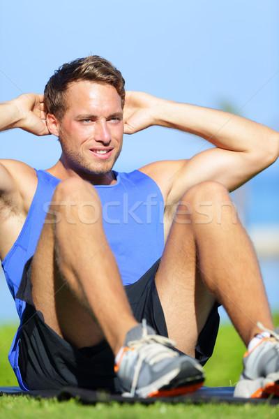 Man doing sit-ups outdoor Stock photo © Maridav