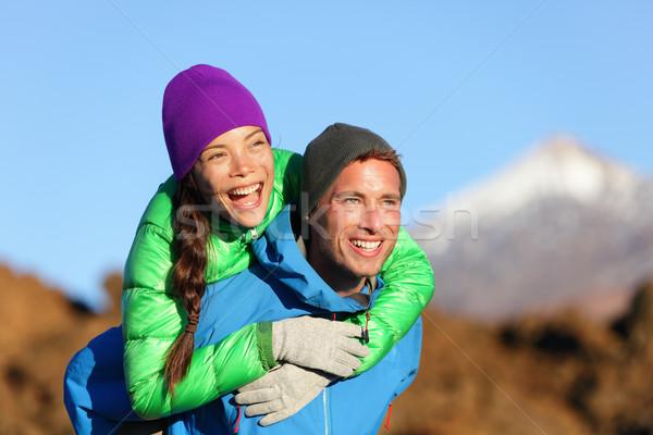 Casal piggyback feliz ativo estilo de vida Foto stock © Maridav