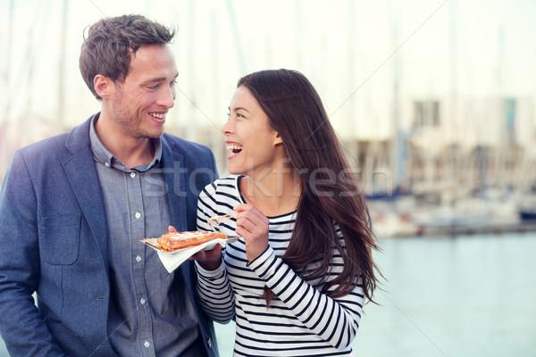 Dating couple tourists eating waffles on date Stock photo © Maridav