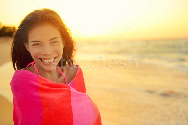 Beach girl happy laughing smiling wrapped in towel Stock photo © Maridav